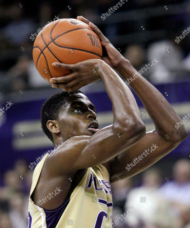 Justin Holiday Washington's Justin Holiday shoots a free throw after being fould by Portland late in the second half of an NCAA college basketball game, in Seattle. Washington won 94-72