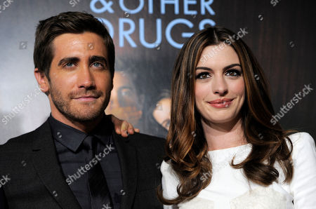 """Anne Hathaway, Jake Gyllenhall Jake Gyllenhaal, left, and Anne Hathaway, cast members in """"Love & Other Drugs,"""" pose together at the premiere of the film on the opening night of American Film Institute's AFI Fest 2010 in Los Angeles"""