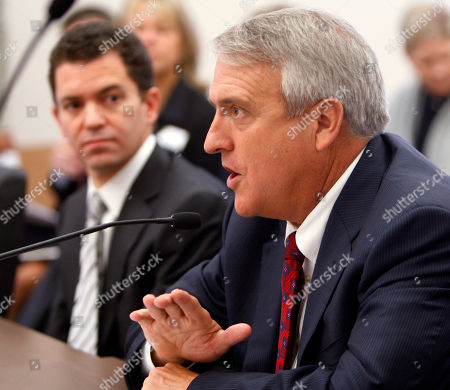 """Bill Ritter Then-Colorado Gov. Bill Ritter, right, speaks before the Joint Budget Committee at the Capitol in Denver. The Denver Post went to court in 2008 seeking access to Ritter's personal cell phone bills. The Supreme Court eventually ruled that the records are not public, prompting a dissenting opinion from two justices who said the court gave public officials a path to conceal public business """"for the price of a monthly cell phone plan"""