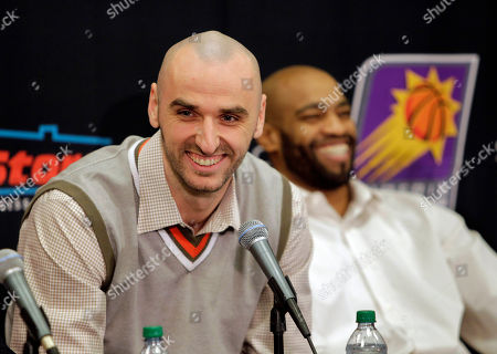 Marcin Gortat, VInce Carter New Phoenix Suns players Marcin Gortat, left, speaks while VInce Carter laughs, in Phoenix. They and Mickael Pietrus were acquired from the Orlando Magic for Jason Richardson, Hedo Turkoglu and Earl Clark