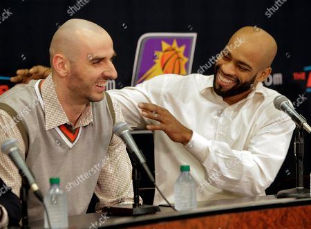 Marcin Gortat, Vince Carter Newly acquired Phoenix Suns' Marcin Gortat, left, and Vince Carter are introduced, in Phoenix. They and Mickael Pietrus were acquired from the Orlando Magic for Jason Richardson, Hedo Turkoglu and Earl Clark