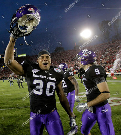 Stock Image of Aundre Dean TCU running back Aundre Dean (30), left, celebrates after winning the Rose Bowl NCAA college football game against Wisconsin, in Pasadena, Calif