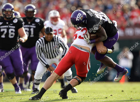 Jimmy Young, Mike Taylor TCU wide receiver Jimmy Young (88) is stopped by Wisconsin linebacker Mike Taylor (53) during the first half of the Rose Bowl NCAA college football game, in Pasadena, Calif