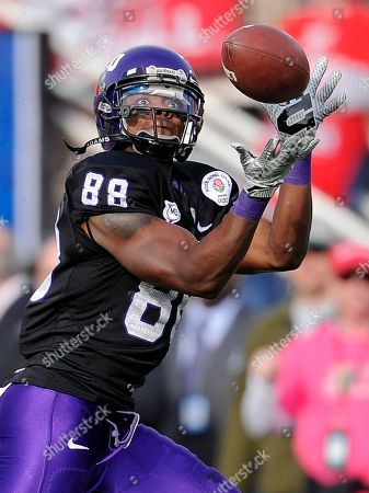 Jimmy Young TCU's Jimmy Young catches a pass during the first half of the Rose Bowl NCAA college football game against Wisconsin, in Pasadena, Calif