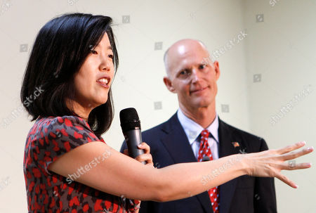 Michelle Rhee, Rick Scott Michelle Rhee, left, speaks to staff and guests as Gov. Rick Scott looks on during a visit to a South Florida charter school in Opa-locka, Fla., . Rhee was on Scott's education transition team, and the new governor said she would continue to serve Florida as an informal education adviser
