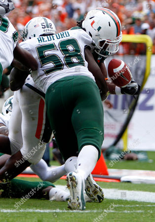 David Bedford, Damien Berry South Florida's David Bedford (58) causes Miami's Damien Berry (20) to fumble ball just short of the goal line during the first half of an NCAA colelge football game in Miami, . South Florida recovered the ball
