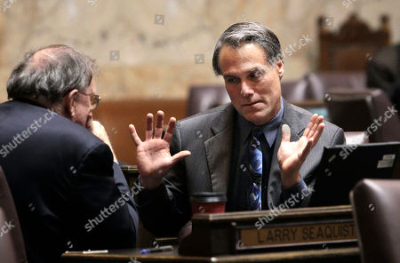 Larry Seaquist, John Driscoll Rep. Larry Seaquist, left, D-Gig Harbor, speaks with Rep. John Driscoll, D-Spokane, before the session, in Olympia, Wash. Washington lawmakers assembled Saturday for an emergency special session to tackle the state's $1.1 billion budget deficit. Majority Democrats and minority Republicans worked together on a budget-savings blueprint that could cut the deficit by about $745 million through June