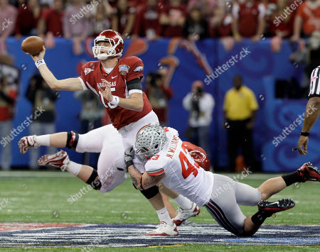 Ryan Mallett Arkansas quarterback Ryan Mallett (15) throws as he is pressured by Ohio State defensive lineman Nathan Williams (43) during the first half of the Sugar Bowl NCAA college football game at the Louisiana Superdome in New Orleans