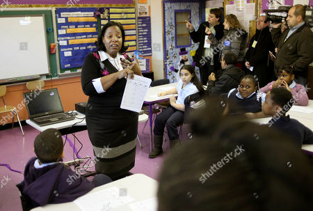 Stephanie Forcer teaches her class at P.S. 262 in New York during a tour by Mayor Michael Bloomberg and Schools Chancellor Cathie Black. New York City's Education Department has released a list estimating the number of teachers that could face layoffs if the state doesn't provide additional funds and seniority rules aren't changed