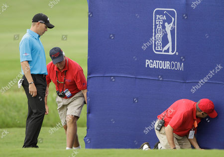 Derek Lamely Derek Lamely looks on as marshals try to retrieve his ball that went under a grandstand at the ninth green during the first round of the Hyundai Tournament of Champions golf tournament in Kapalua, Hawaii