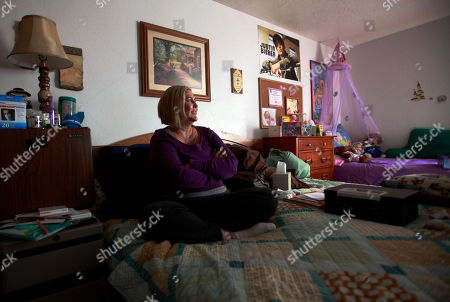 "Keri Kirkham, 41, Elaine and Gregory Kearney's daughter with lung cancer, rests in her parents' home in Hinkley, Calif., in the Mojave Desert northeast of Los Angeles, . A California state study has not revealed elevated cancer levels in the town, a small community whose struggles with contaminated groundwater inspired the award-winning Hollywood movie ""Erin Brockovich"