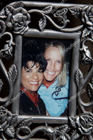 "Roberta Walker In a photo, Roberta Walker is seen at left with Erin Brockovich in this undated framed photo on display in Walker's home in Hinkley, Calif., in the Mojave Desert northeast of Los Angeles. A California state study has not revealed elevated cancer levels in the town, a small community whose struggles with contaminated groundwater inspired the award-winning Hollywood movie ""Erin Brockovich."" Earlier this year, Walker and other residents learned that the pollution, which Pacific Gas & Electric was required to clean up, was once again moving and had seeped into their groundwater. Now, Brockovich has returned to the town that made her famous and is once again rallying residents"