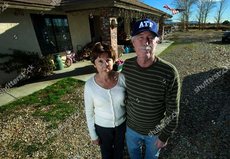 "Elaine Kearney, 63, who has had seven strokes, and her husband Greg, 64, stand outside their home in Hinkley, Calif., in the Mojave Desert northeast of Los Angeles, . A California state study has not revealed elevated cancer levels in the town, a small community whose struggles with contaminated groundwater inspired the award-winning Hollywood movie ""Erin Brockovich"