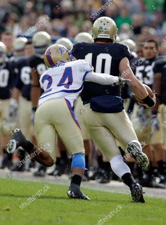 Stock Photo of Dayne Crist, Charles Davis Notre Dame quarterback Dayne Crist, right, is hit by Tulsa cornerback Charles Davis as he picks up a first down during the first half of an NCAA college football game, in South Bend, Ind. Crist was injured on the play and did not return in the first half