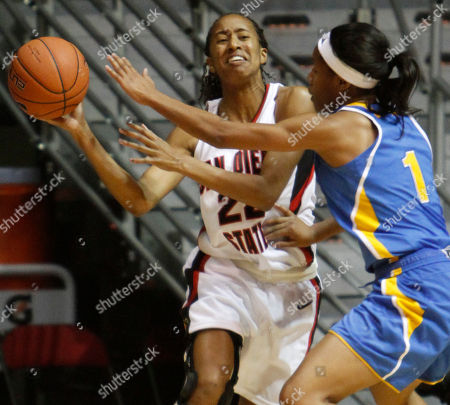 Gabrielle Clark, Nina Earl San Diego State's Gabrielle Clark battles to get a pass off while being trapped in the corner by UCLA's Nina Earl in the first half of an NCAA college basketball game, in San Diego