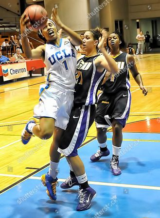 UCLA's Nina Earl(1) drives to the basket past East Carolina Pirates Kelly Smith during their game at the Rainbow Wahine Shootout at the Afook-Chinen Civic Auditorium, Hilo, Hawaii, Monday evening