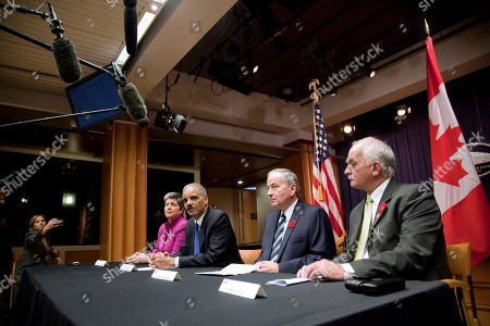 Stock Photo of Eric Holder, Janet Napolitano, Rob Nicholson, Vic Toews Attorney General Eric Holder, second from left, speaks during a news conference on cross-border crime, at the Justice Department in Washington. From left are, Homeland Security Secretary Janet Napolitano, Holder, Canadian Attorney General Rob Nicholson, and Canadian Minister of Public Safety Vic Towes
