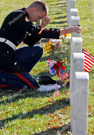 Bryan Murray Marine Sgt. Bryan Murray kneels at the grave of fellow Marine David James Smith in Section 60, on Veterans' Day, at Arlington National Cemetery in Arlington, Va