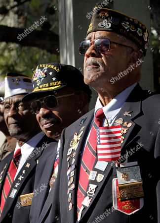 Retired Air Force Master Sgt.'s Bob Wright, right, John McCants, center and Floyd Clark, observe Veterans Day ceremonies held at the Sacramento Veterans Affairs Medical Center in Rancho Cordova, Calif