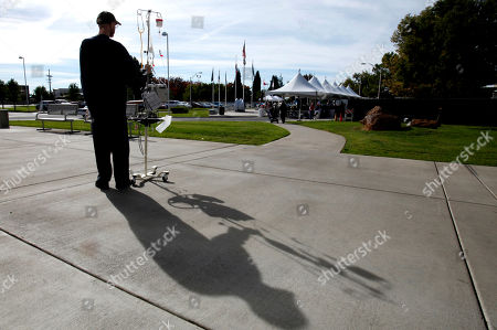 Michael Bruce, a patient at the Sacramento Veterans Affairs Medical Center, watches a Veterans Day ceremony held at the center in Rancho Cordova, Calif., . Bruce who served six years in the U.S. Army in the 84th Engineer Battalion of the 45th Support Group, received a medical discharge