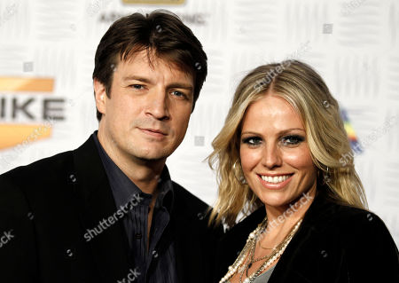 Nathan Fillion, Kate Luyben Nathan Fillion, left, and Kate Luyben arrive at Spike TV's Video Game Awards, in Los Angeles