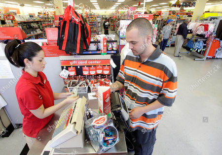 Stock Image of In this photo take, Family Dollar employee Pamela Ramos, left, assists John Conner, right, of Waco, Texas, with a purchase at a store, in Waco, Texas