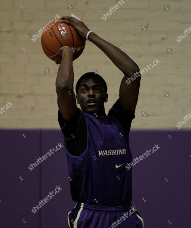 Justin Holiday Washington's Justin Holiday shoots during practice, in Seattle as the team prepares for the upcoming NCAA college basketball season