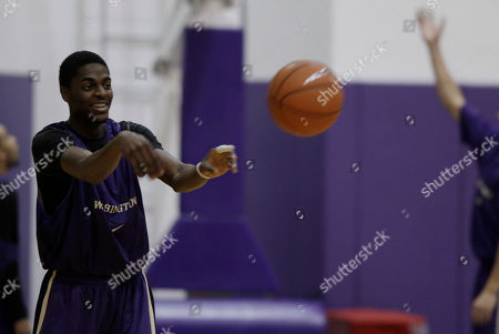 Justin Holiday Washington's Justin Holiday passes during practice, in Seattle as the team prepares for the upcoming NCAA college basketball season