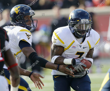 Geno Smith, Noel Devine West Virginia running back Noel Devine (7) looks for running room as he takes a handoff from quarterback Geno Smith during the first half of their NCAA college football game against Louisville in Louisville, Ky