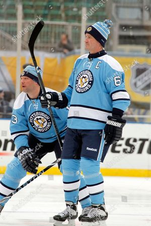Stock Photo of Mario Lemieux, Bill Guerin Pittsburgh Penguins Hall of Fame co-owner Mario Lemieux (66) and Bill Guerin (13) participate in an exhibition hockey game against alumni of the Washington Capitals in Pittsburgh . The game ended tied at 5-5