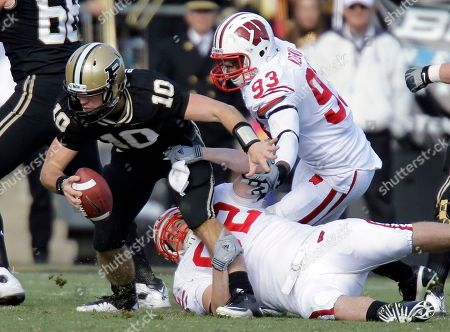 Pat Muldoon, Louis Nzegwu, Sean Robinson Purdue quarterback Sean Robinson, left, is tackled by Wisconsin defensive tackles Louis Nzegwu (93) and Pat Muldoon (92) during the first half of an NCAA college football game in West Lafayette, Ind