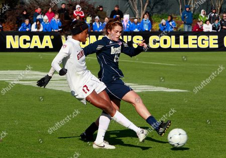 Notre Dame's Courtney Barg, right, defends as Stanford's Lindsay Taylor (17) moves the ball during the second half of an NCAA Women's College Cup soccer tournament final in Cary, N.C., . Notre Dame won 1-0