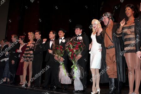 (Starting from 5th along (L-R), Brad Musgrove as Carmen Ghia, Lee Roy Reams as Roger DeBris, Tony Danza, as Max Bialystock, Roger Bart as Leo Bloom, Angie Schworer as Ulla, Bill Nolte as Franz Liebkind and cast