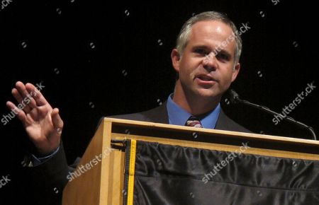 Republican Tim Huelskamp answers questions during a debate in Kansas' 1st Congressional District race, Monday night, at Emporia State University in Emporia, Kan
