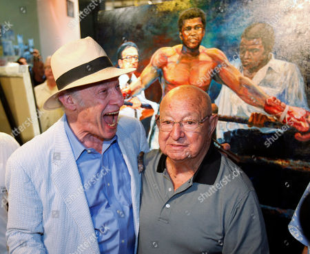 Angelo Dundee, Bert Sugar Bert Sugar, left, shares a laugh with Angelo Dundee as they pose for photos at the opening of the new 5th Street Gym, in Miami Beach, Fla. Dundee's brother, Chris Dundee, opened the original gym in 1951 and it eventually hosted Muhammad Ali, Joe Louis, Rocky Marciano, Sugar Ray Robinson and many others. It was torn down 17 years ago, five years before Chris Dundee's death
