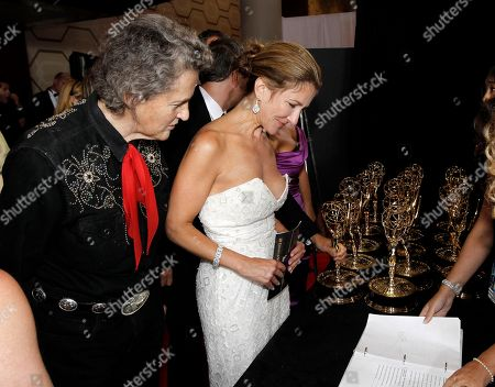 """Temple Grandin, Emily Gerson Saines Producer Emily Gerson Saines, right, and Temple Grandin collect the award for outstanding made for TV movie for """"Temple Grandin"""" during the 62nd Primetime Emmy Awards, in Los Angeles"""
