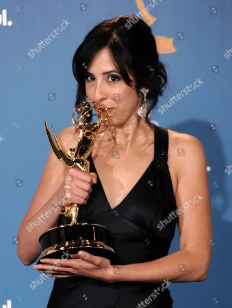"Erin Levy Writer Erin Levy poses in the press room with her award for outstanding writing for a drama series for her work on the ""Mad Men"" episode titled ""Shut the Door"" during the 62nd Primetime Emmy Awards, in Los Angeles"
