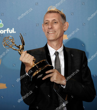 """Stock Photo of Steve Shill Director Steve Shill poses in the press room with the award for outstanding directing for a drama series for his work on the """"Dexter"""" episode titled """"The Getaway"""" during the 62nd Primetime Emmy Awards, in Los Angeles"""