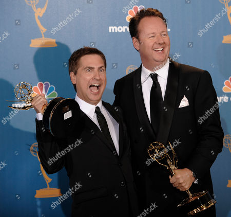 """Dave Boone, Paul Greenberg Writers Dave Boone, right, and Paul Greenberg pose in the press room with their awards for outstanding writing for a variety, music or comedy special for """"63rd Annual Tony Awards"""" during the 62nd Primetime Emmy Awards, in Los Angeles"""