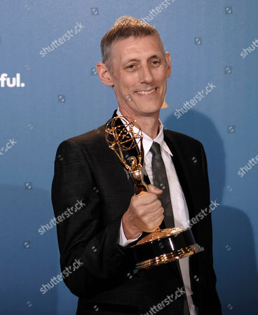 """Stock Picture of Steve Shill Director Steve Shill poses in the press room with the award for outstanding directing for a drama series for his work on the """"Dexter"""" episode titled """"The Getaway"""" during the 62nd Primetime Emmy Awards, in Los Angeles"""