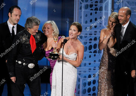 """Emily Gerson Saines, Gil Bellows, Temple Grandin, Alison Owen, Claire Danes, Anthony Edwards Producer Emily Gerson Saines accepts the award for outstanding made for television movie for """"Temple Grandin"""" during the 62nd Primetime Emmy Awards, in Los Angeles. From left are Gil Bellows, Temple Grandin, Alison Owen, Claire Danes and Anthony Edwards"""
