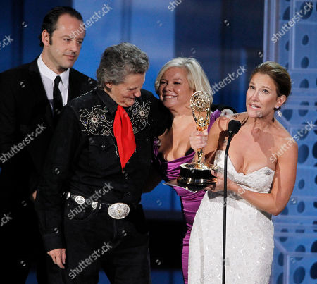 """Emily Gerson Saines, Gil Bellows, Temple Grandin, Alison Owen Producer Emily Gerson Saines accepts the award for outstanding made for TV movie for """"Temple Grandin"""" during the 62nd Primetime Emmy Awards, in Los Angeles. From left are Gil Bellows, Temple Grandin and producer Alison Owen"""