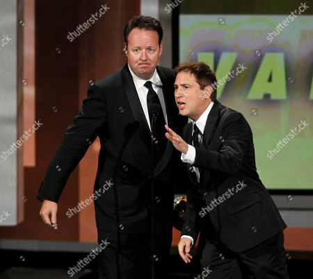 """Dave Boone, Paul Greenberg Dave Boone and Paul Greenberg accept the award for outstanding writing for a variety, music, or comedy special for the """"63rd Annual Tony Awards"""" during the 62nd Primetime Emmy Awards, in Los Angeles"""
