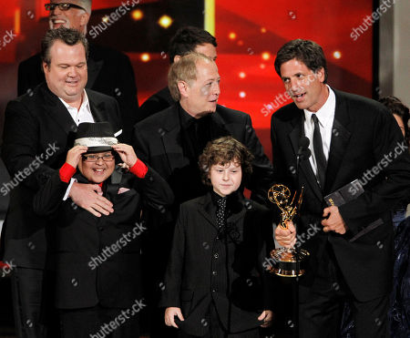 "Steven Levitan Steven Levitan, right, and the cast of ""Modern Family"" accept the award for outstanding comedy series during the 62nd Primetime Emmy Awards, in Los Angeles. From left are Eric Stonestreet, Rico Rodriguez, writer Danny Zuker and Nolan Gould, second right at bottom"