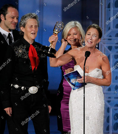 """Stock Picture of Emily Gerson Saines, Temple Grandin, Alison Owen Producer Emily Gerson Saines accepts the award for outstanding made for TV movie for """"Temple Grandin"""" during the 62nd Primetime Emmy Awards, in Los Angeles. Behind Saines are Temple Grandin, left, and producer Alison Owen"""