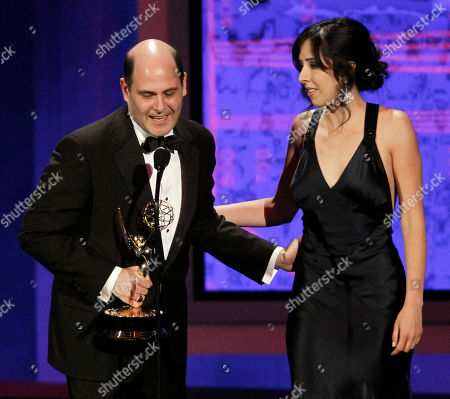 "Matthew Weiner, Erin Levy Matthew Weiner, left, and Erin Levy accept the award for outstanding writing for a drama series for ""Mad Men"" during the 62nd Primetime Emmy Awards, in Los Angeles"