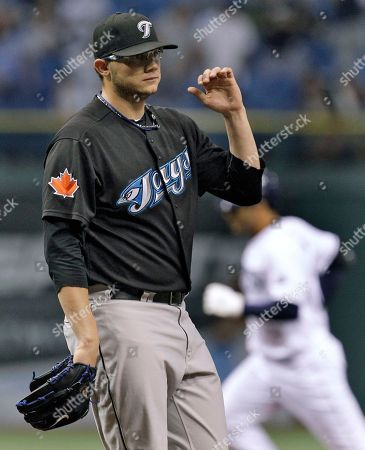 Stock Photo of Brett Cecil Toronto Blue Jays starting pitcher Brett Cecil reacts as Tampa Bay Rays' Carlos Pena, right, rounds the bases after Pena hit a three-run home run in the third inning during a baseball game, in St. Petersburg, Fla. Rays' Evan Longoria and Carl Crawford also scored on the play