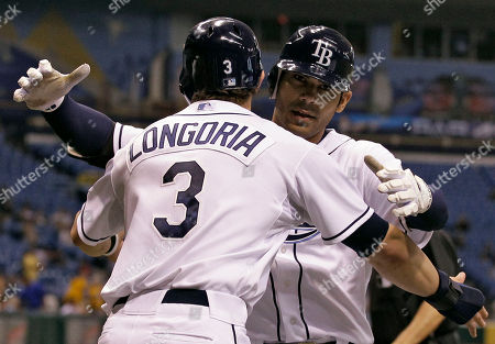 Stock Image of Carlos Pena, Evan Longoria Tampa Bay Rays' Carlos Pena hugs teammate Evan Longoria (3) after Pena hit a three-run home run off Toronto Blue Jays starting pitcher Brett Cecil in the third inning during a baseball game, in St. Petersburg, Fla. Rays' Car Crawfrod also scored on the play