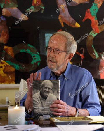 """Elmore Leonard Author Elmore Leonard holds a copy of his new book """"Djibouti,"""" during an interview at his home in Bloomfield Township, Mich"""