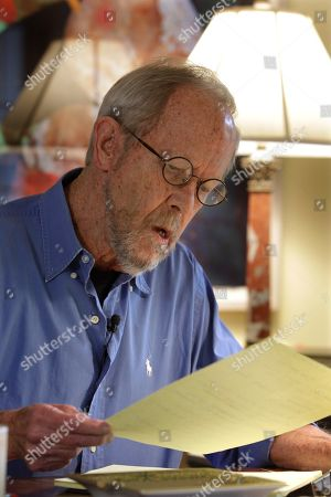 """Elmore Leonard Author Elmore Leonard works on a manuscript at his home in Bloomfield Township, Mich., . He's two decades past the age when most Americans begin receiving Social Security benefits. And the Hot Kid's never been hotter. Leonard's 44th novel, """"Djibouti,"""" hit shelves on Tuesday, a day after he celebrated his 85th birthday"""